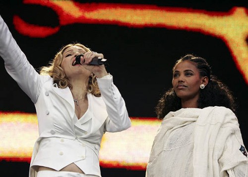 "Madonna performs on stage next to 24-year-old student Birhan Woldu, former Ethiopian famine victim and the inspiration for Live Aid 1985, at ""Live 8 London"" in Hyde Park on July 2, 2005 in London, England."