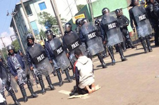 The Salat Man is a lone worshiper who was encircled by riot police